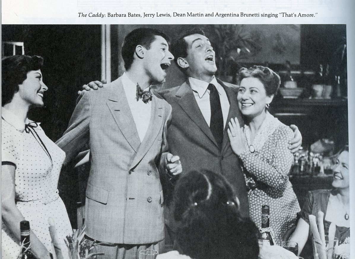 "A still from the movie, The Caddy, showing a scene in which Jerry Lewis, Dean Martin, Barbara Bates, and Argentina Brunetti sing the song, ""That's Amore."""
